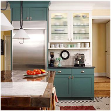 White Upper Cabinets Above Lower Cabinets In A Fun Blue Shade In A Country  Kitchen.